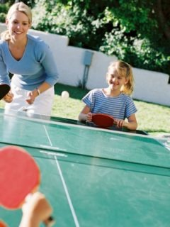 Picture of a family playing ping pong
