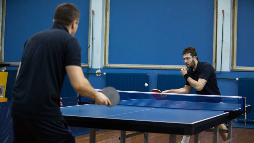 Picture of competitive table tennis.