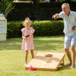 Picture of people playing cornhole