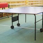 Picture of a ping pong room with a table