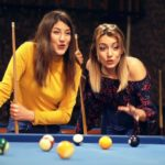 Picture of people playing pool